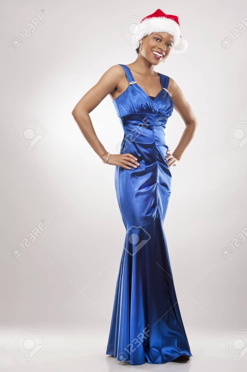 beautiful woman wearing blue evening dress and Christmas hat Stock Photo - 22172747