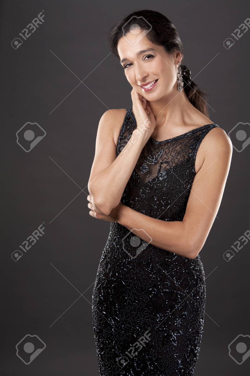 Beautiful Woman In Her 40s Wearing Black Evening Dress On Light ...