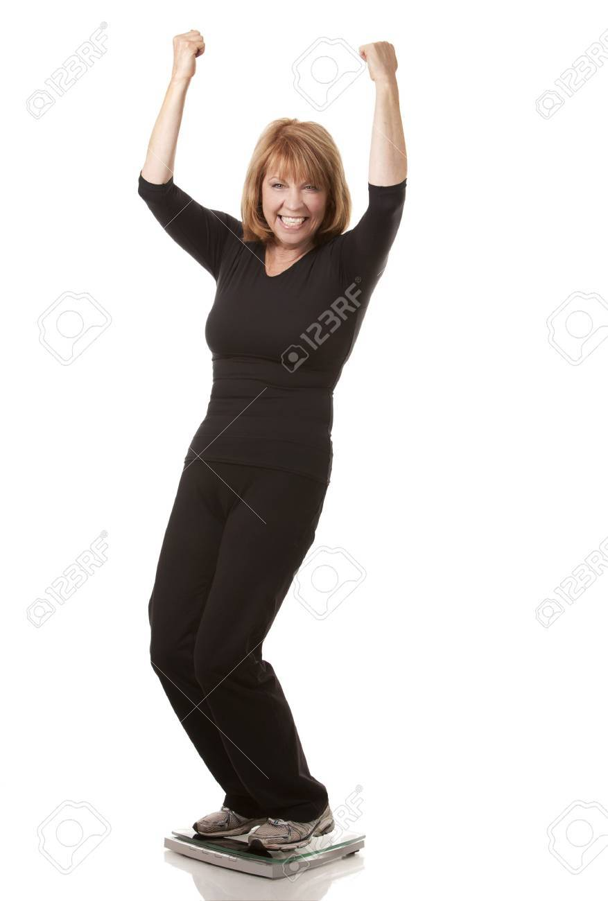 mature woman is standing on weight scale white background Standard-Bild - 23545050