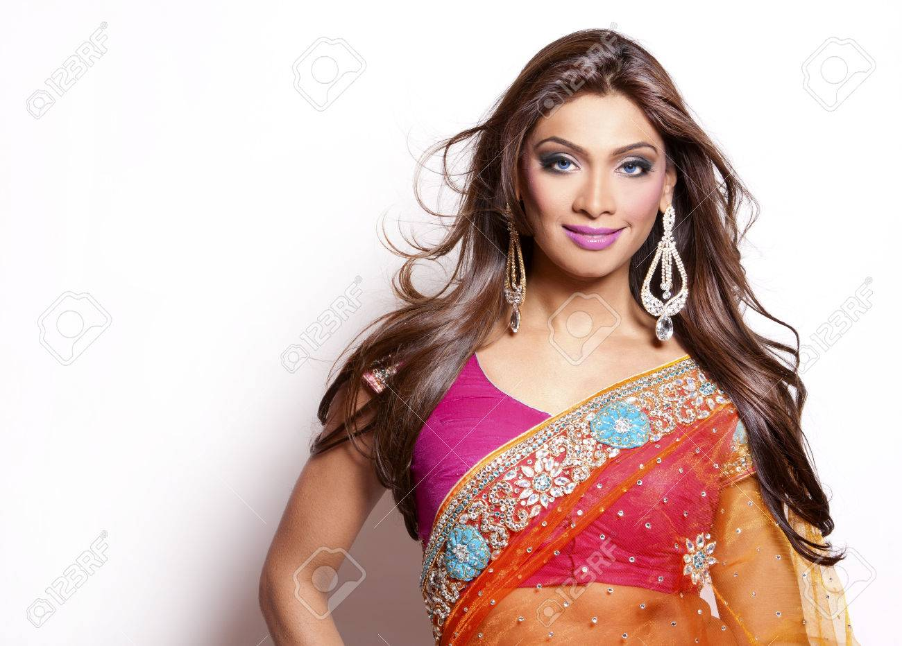 beautiful woman wearing indian traditional outfit on white background Standard-Bild - 28256677