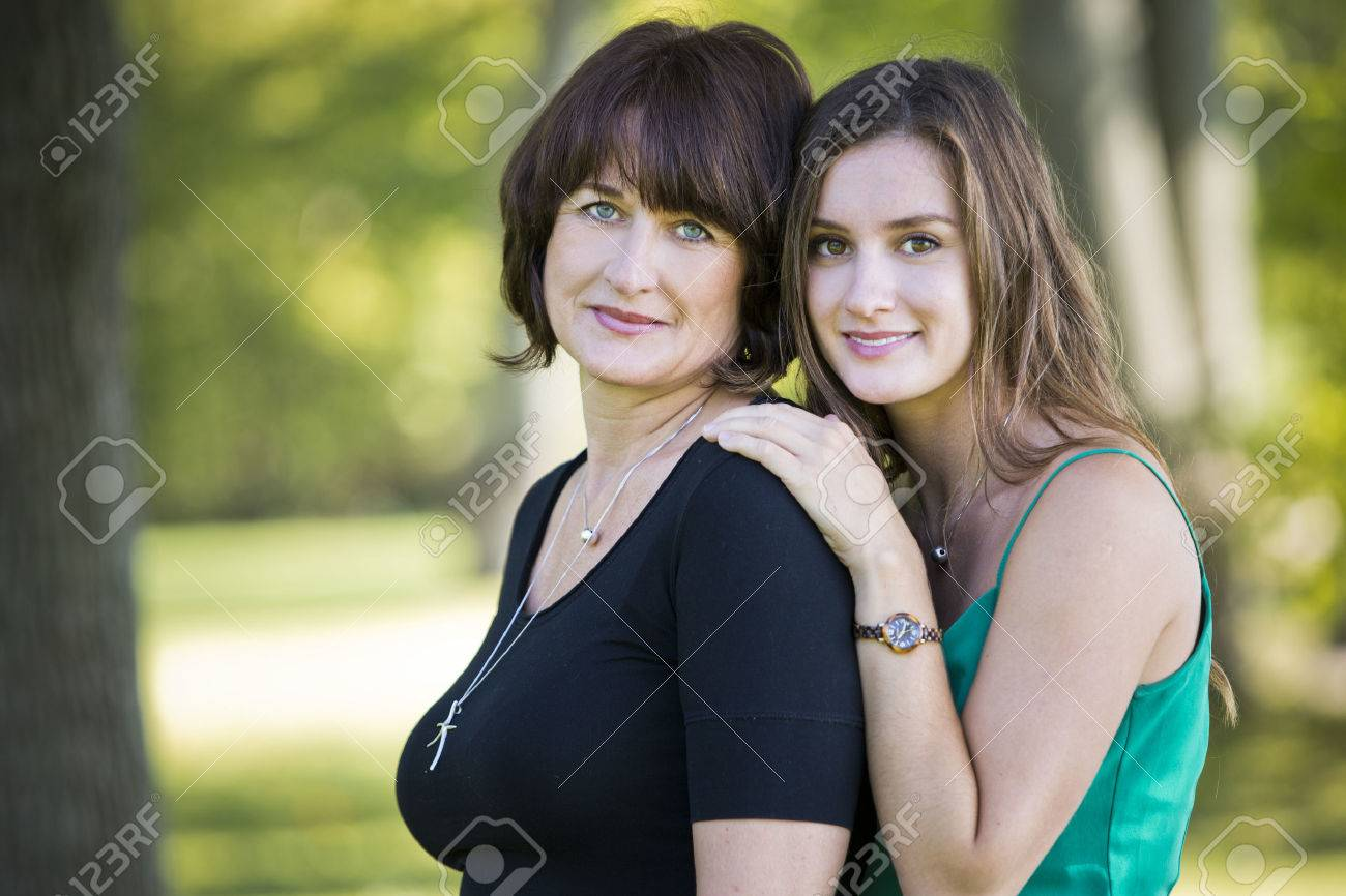caucasian mother and daughter together in the park - 46944082