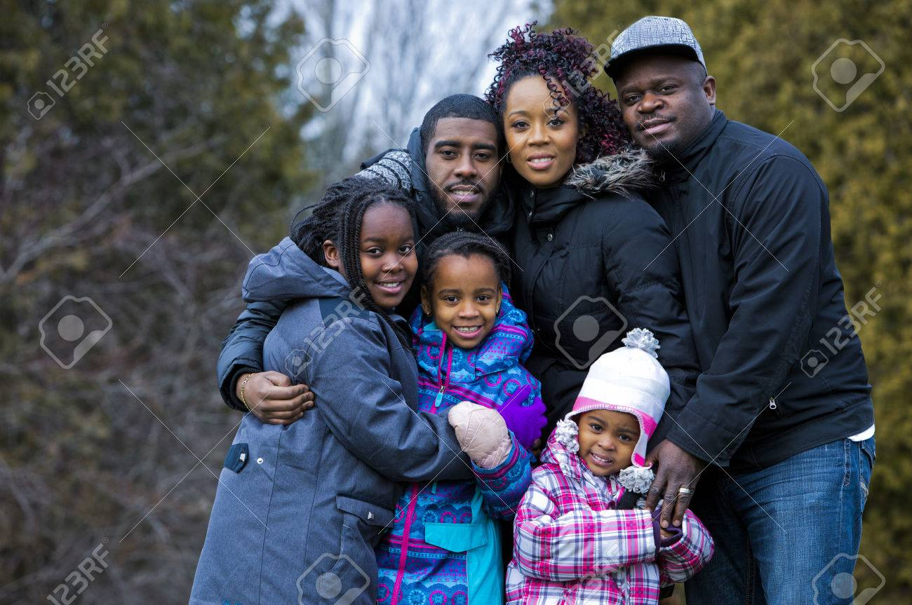 casual winter young black family outdoors in the park Standard-Bild - 49698479