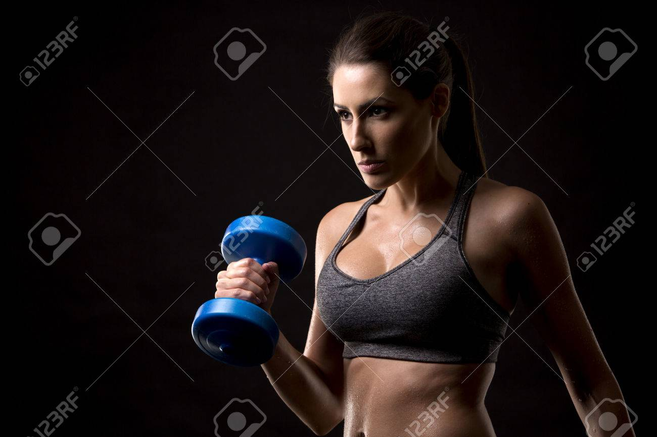 pretty caucasian fitness woman on black isolated background Standard-Bild - 50271621