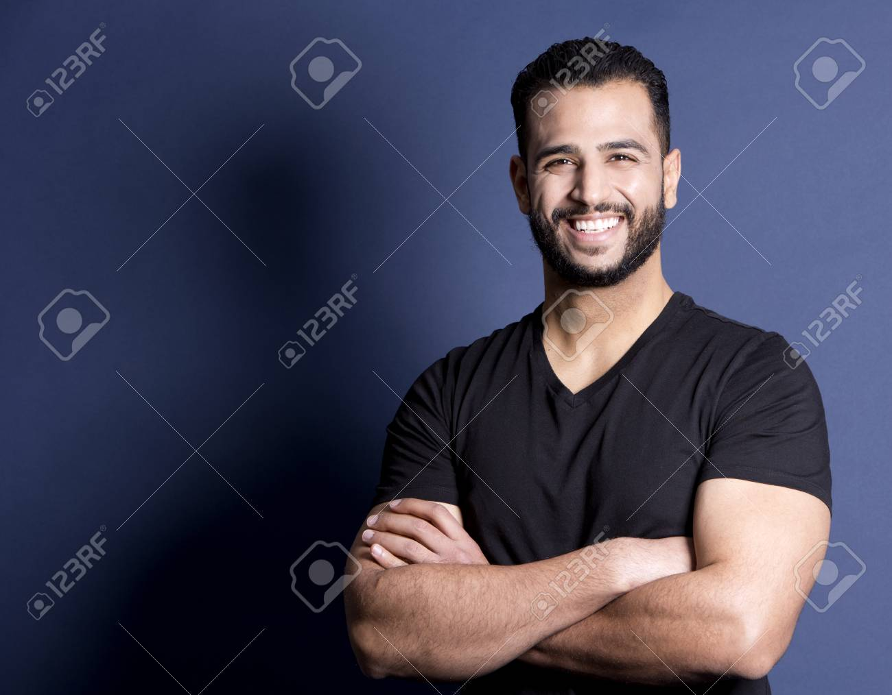 east asian handsome man wearing black tshirt and jeans - 56911619