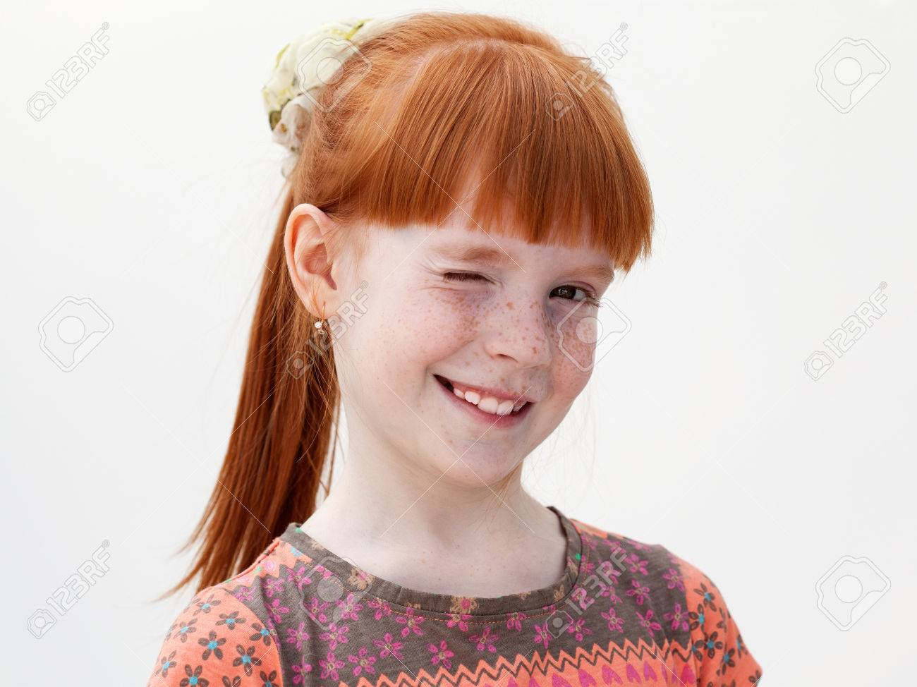 close up portrait of a ginger girl winking stock photo, picture and