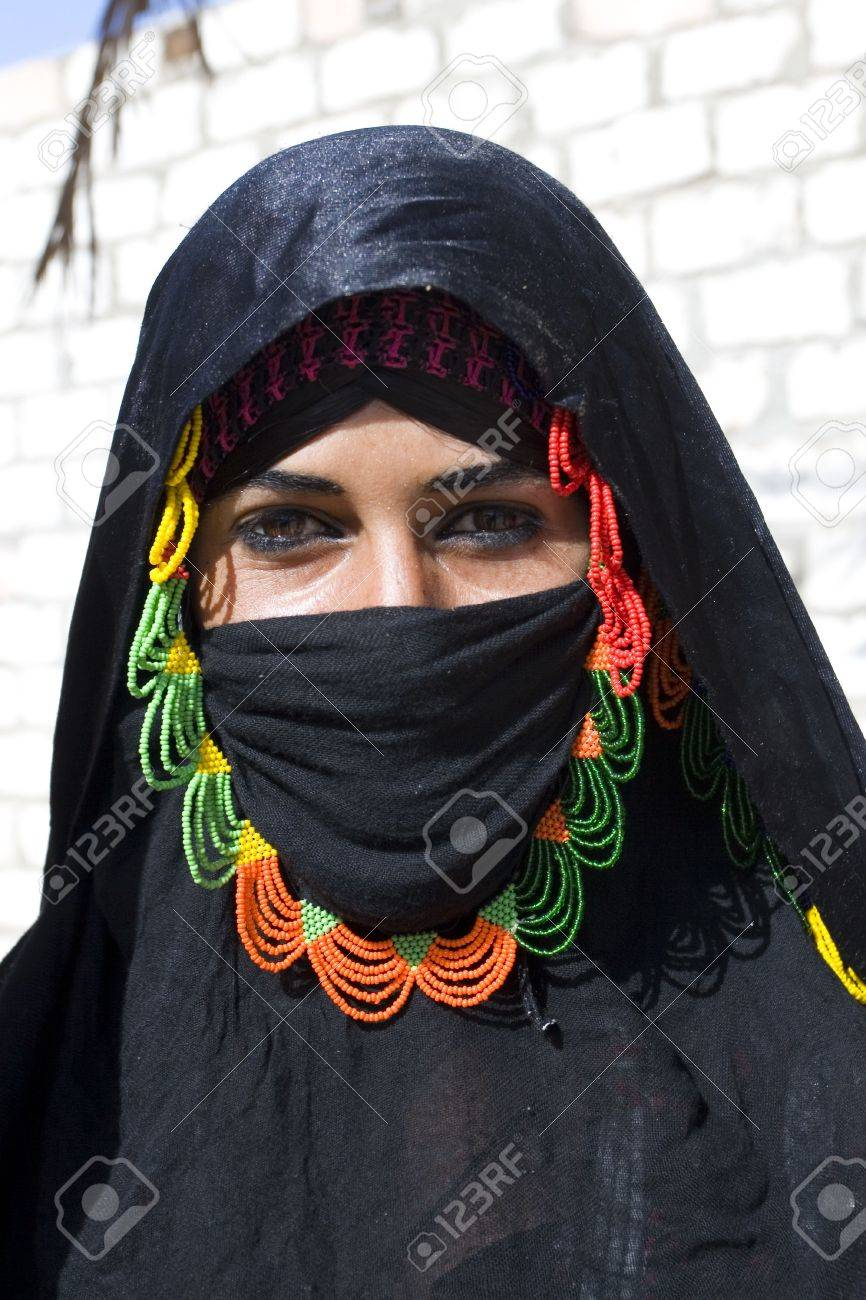 HURGHADA, EGYPT - AUGUST 4: Portrait of young Arabian woman wearing a black head covering on August 4, 2010 in Hurghada, Egypt. Hurghada is a very popular health resort for tourist from Europe.  Stock Photo - 7660253