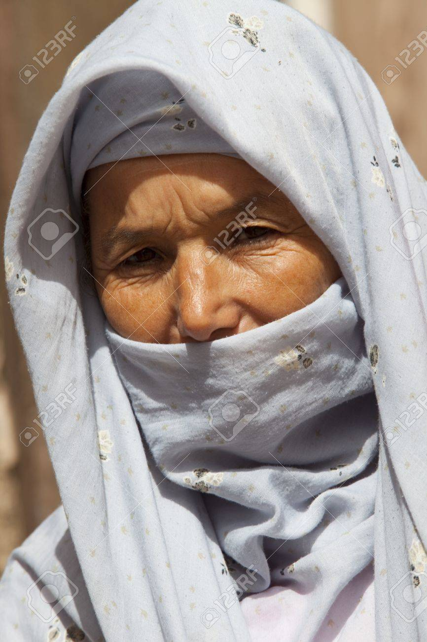 MARRAKECH, MOROCCO - AUGUST 1: Portrait of Arabian woman wearing a head covering at Djemaa el Fna square on August 1, 2011 in Marrakech, Marocco. Marrakech is a popular tourist place from Europe.  Stock Photo - 10274116
