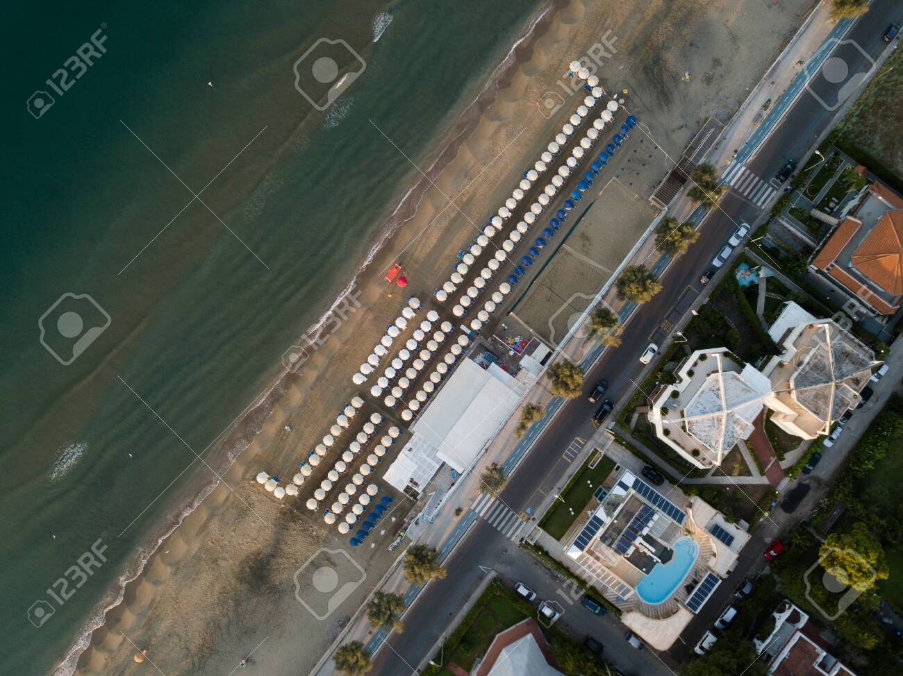 Top view of a coastal town with a beach and beach umbrellas. Terracina, Province of Latina, Lazio Region, Italy - 135780968