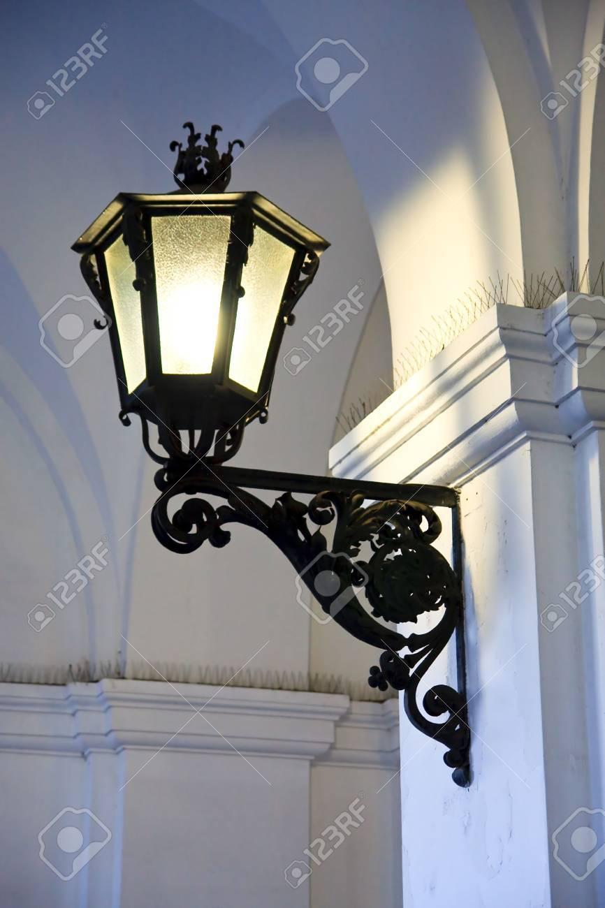 Iron cast street light illuminating old arches Stock Photo - 6869665