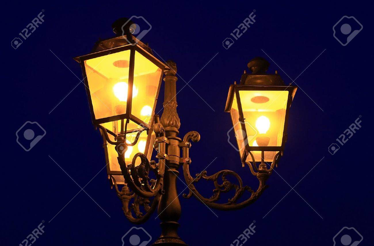 Three old lanterns @ dusk Stock Photo - 9459556