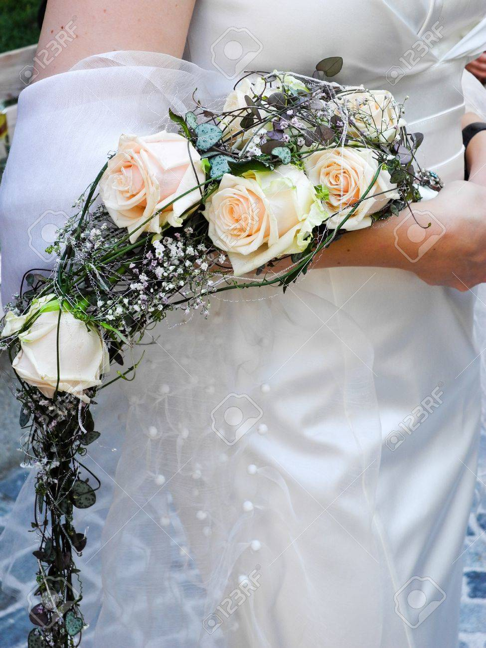 Bride holding her bridal flower bouquet in her hand Stock Photo - 11392940