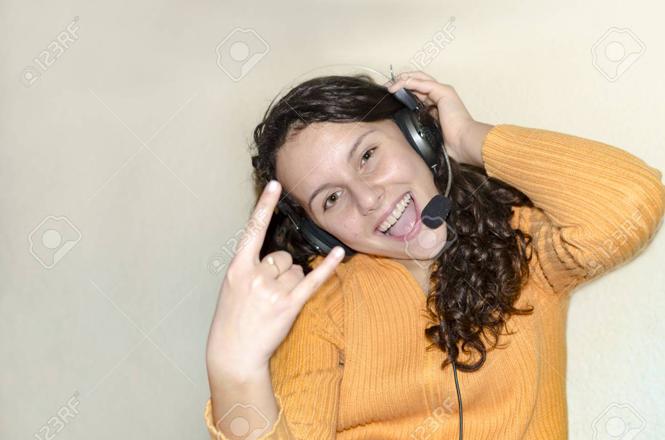 Party teen girl having fun listening music on headphones Stock Photo -  103114245