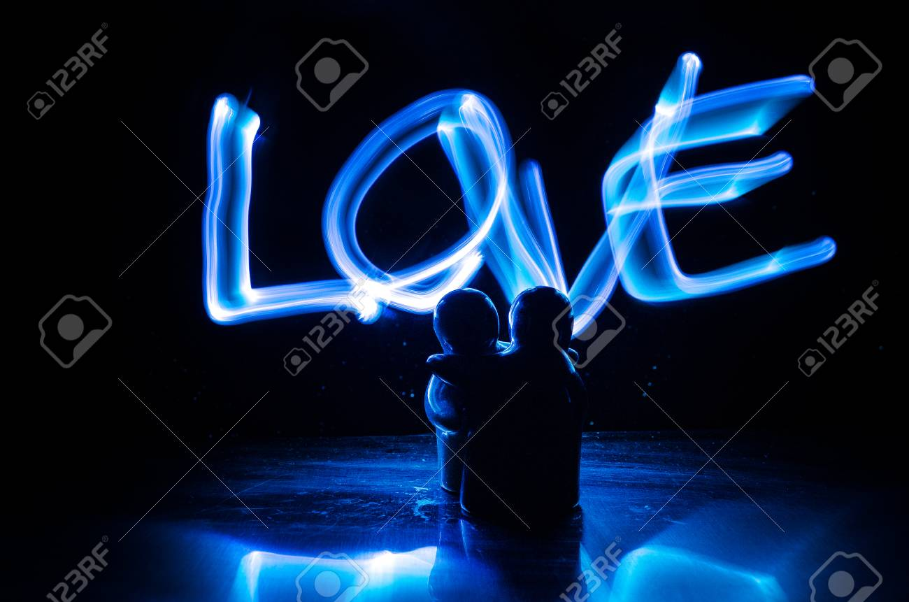 Two Young Lovers Paint A Heart On Fire Silhouette Of Couple Stock Photo Picture And Royalty Free Image Image 79638953