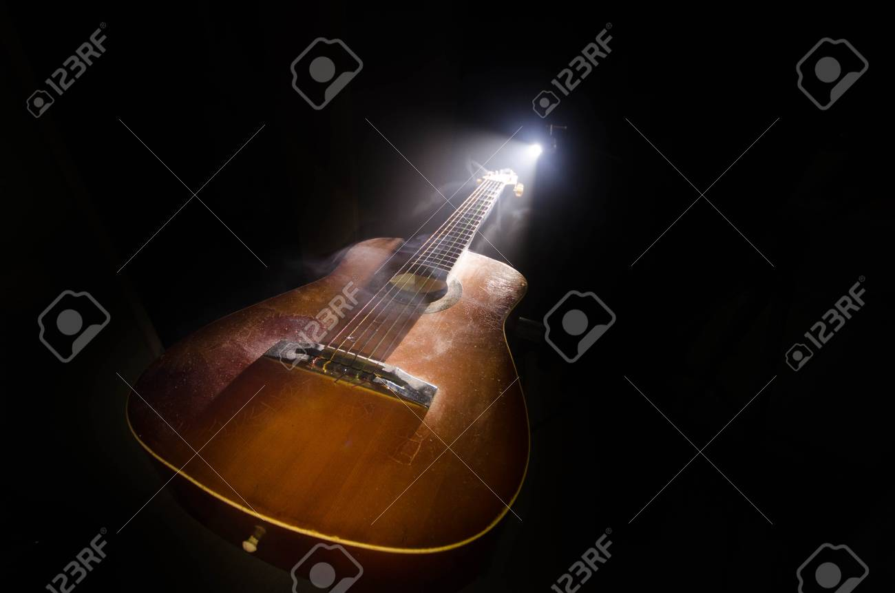 Music Concept Acoustic Guitar Isolated On A Dark Background Stock