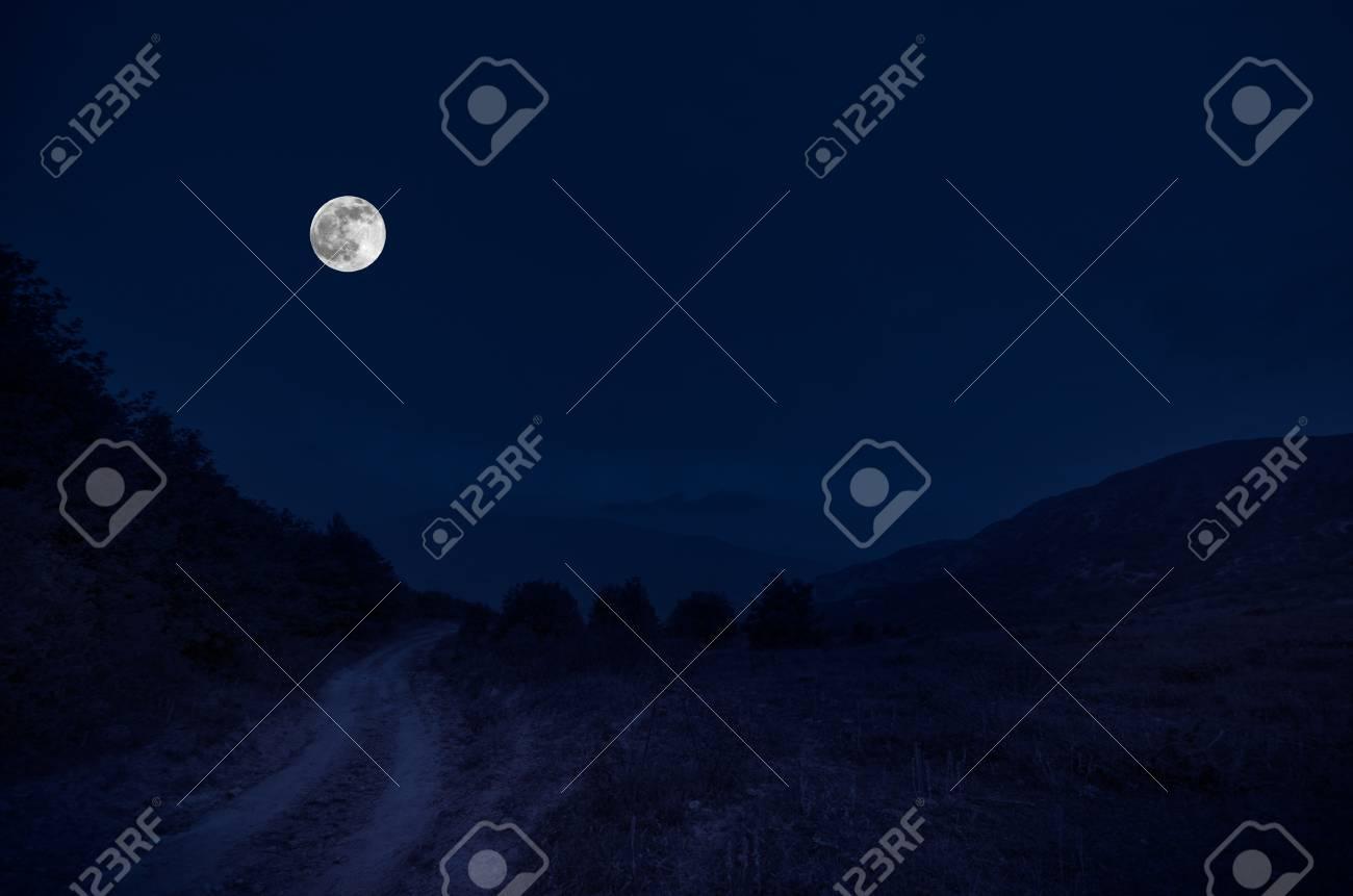 quality products elegant shoes various design Route de montagne à travers la forêt sur une nuit de pleine lune. Paysage  de nuit pittoresque du ciel bleu foncé avec la lune. Azerbaïdjan