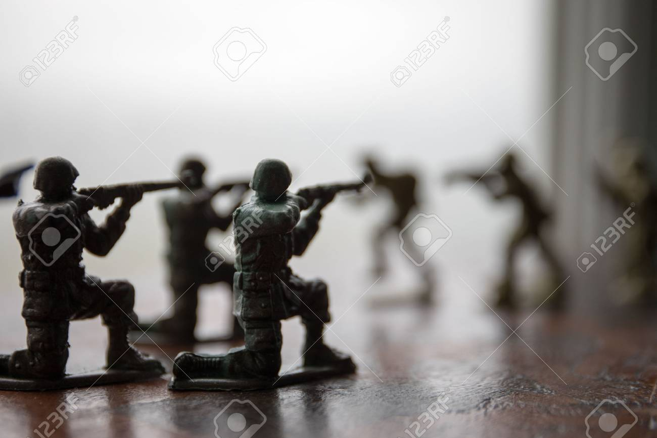 miniature toy soldiers and tank on board  Close up image of toy