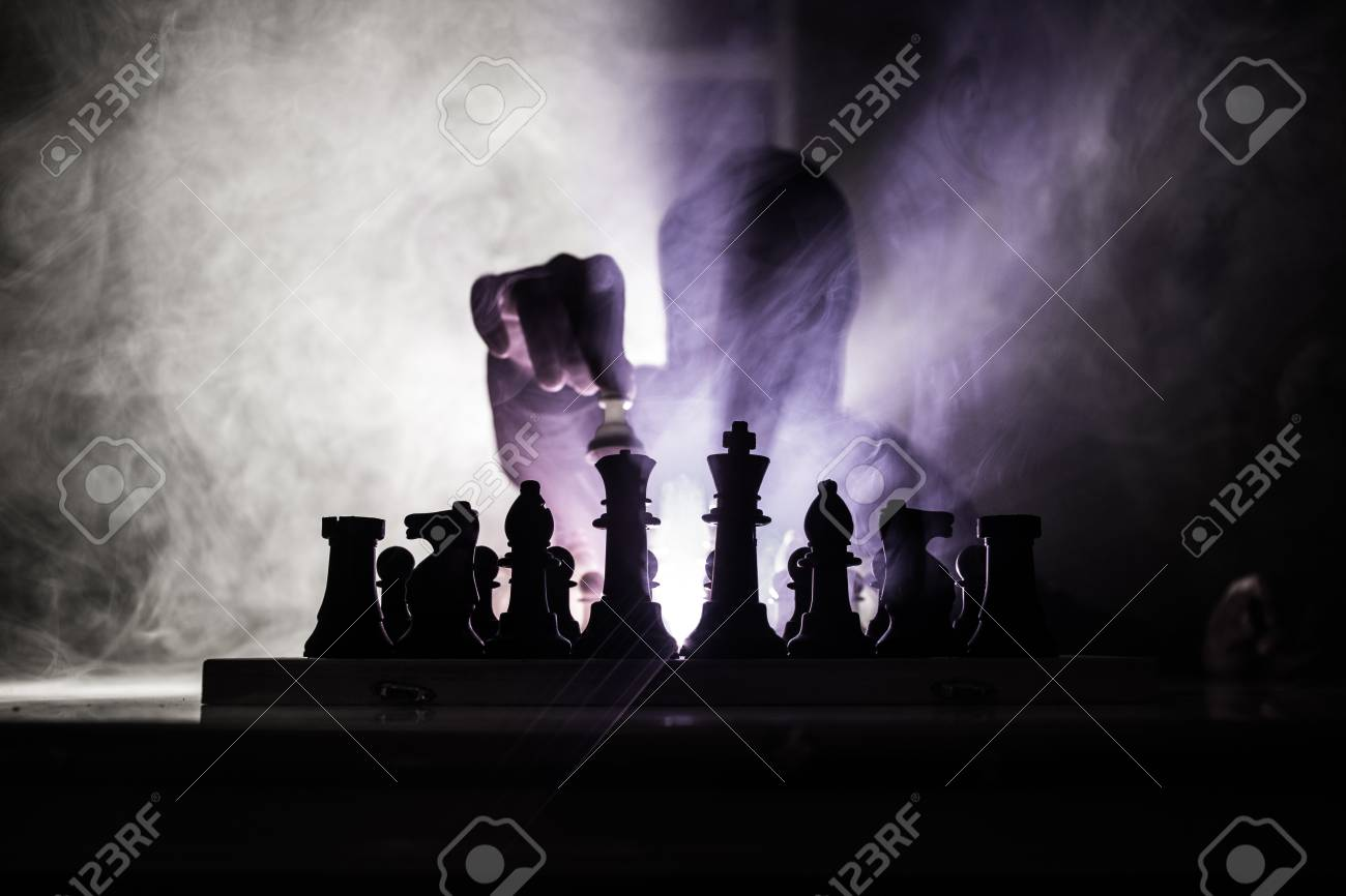 Man playing chess  Scary blurred silhouette of a person at the