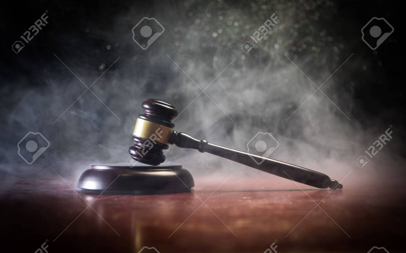 Law theme, mallet of the judge on wooden desk with Lady Justice Statue. Law gavel on dark foggy background with light. Selective focus - 120671196