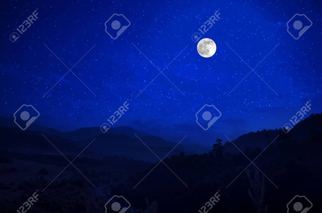 Mountain Road through the forest on a full moon night. Scenic night landscape of country road at night with large moon - 121517647
