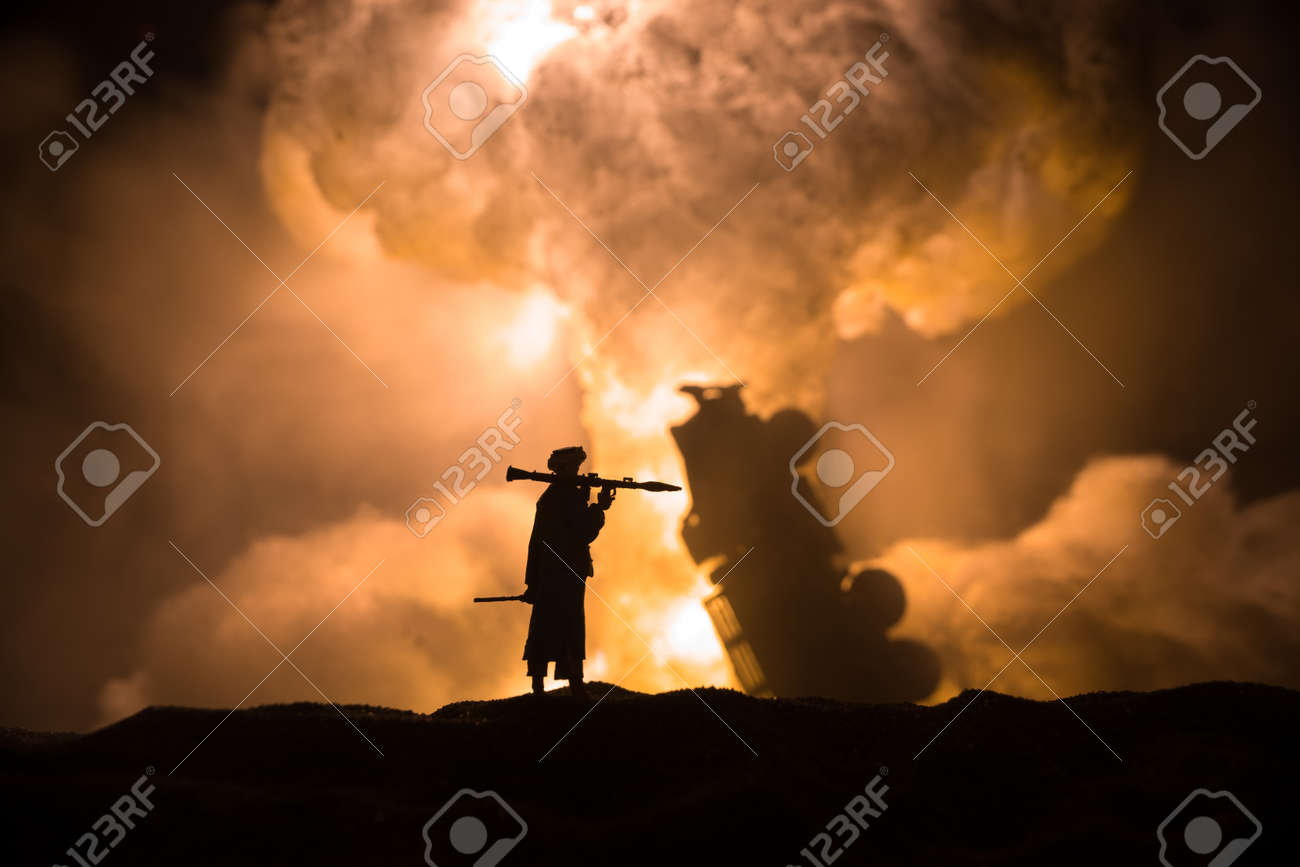 Military soldier silhouette with bazooka. War Concept. Military silhouettes fighting scene on war fog sky background, Soldier Silhouette aiming to the target at night. Attack scene - 171854290