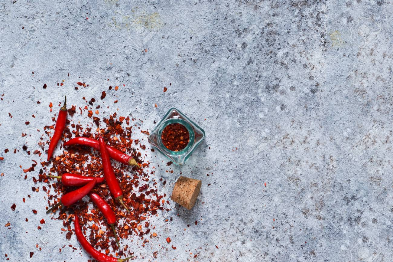 Hot Chili Peppers On Concrete Background Advertising With Space For The Text Top View