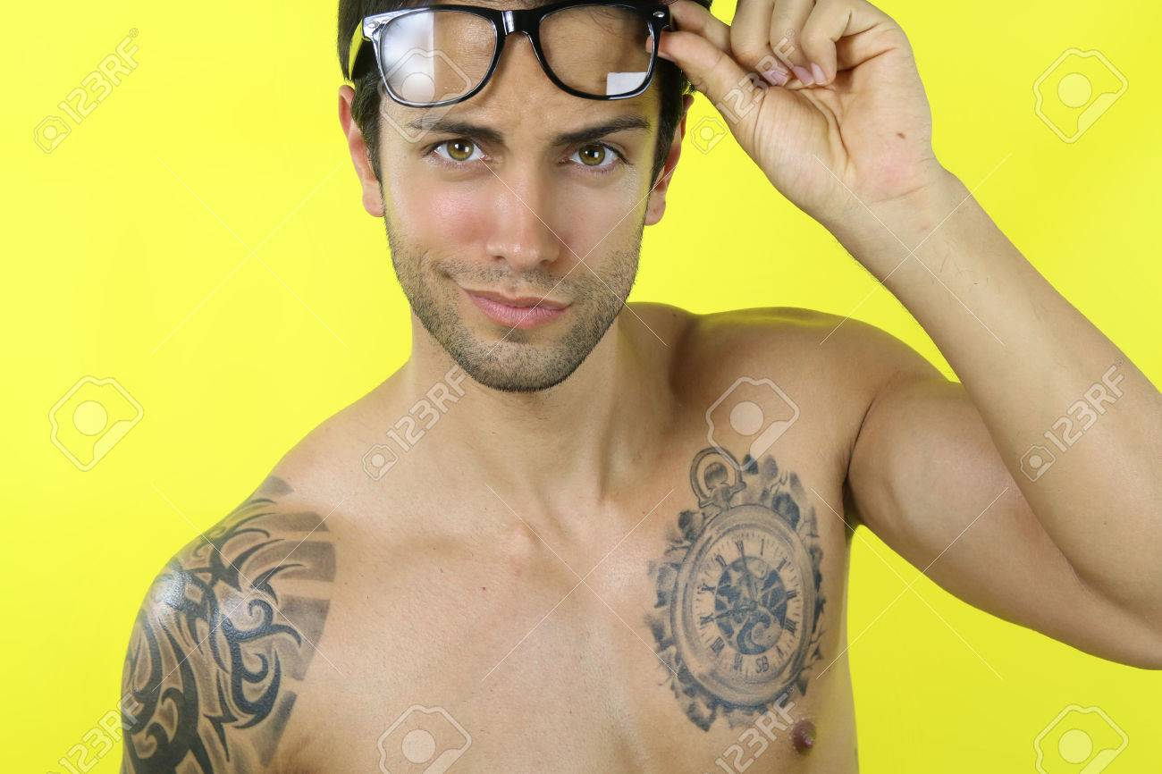 39576473-sexy-man-wearing-glasses-on-a-yellow-background-Stock-Photo.jpg