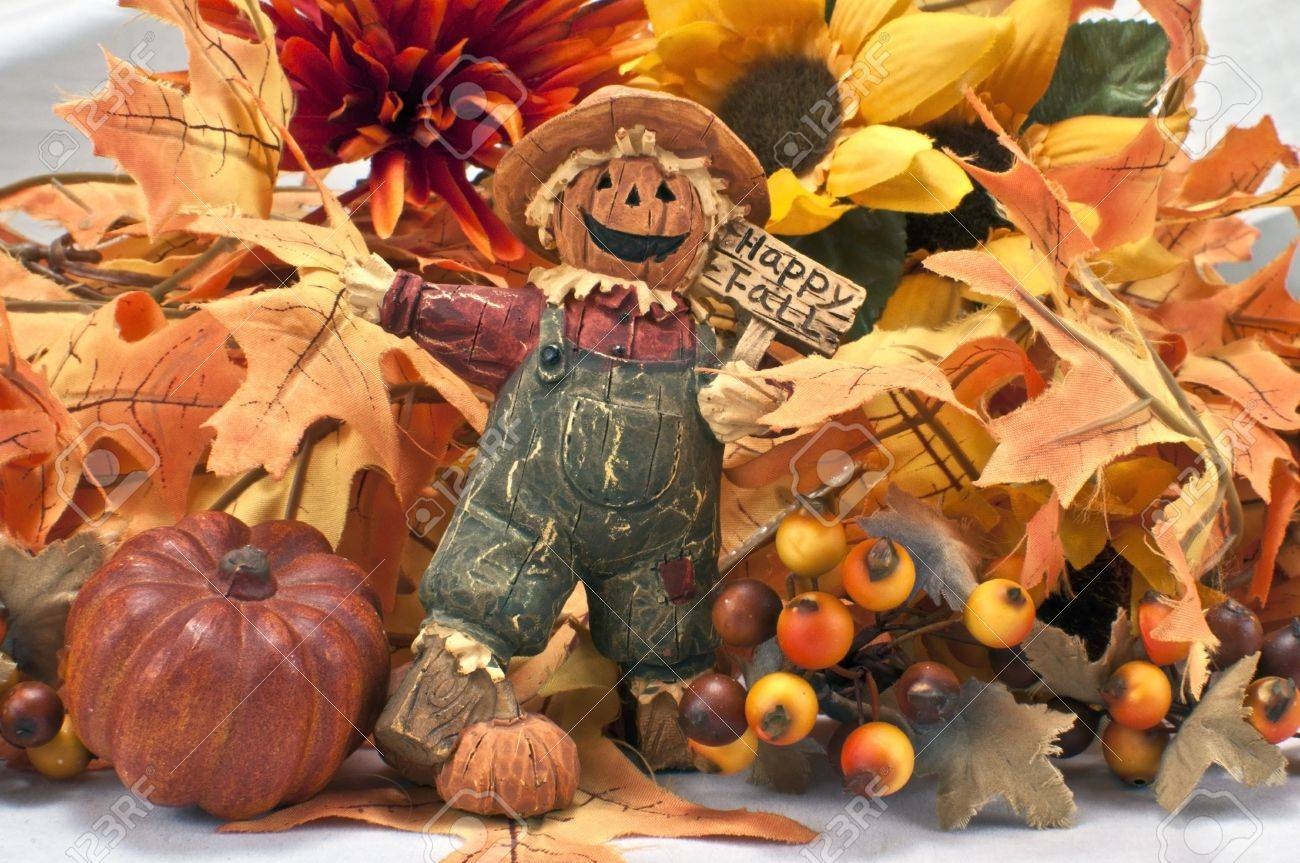 Halloween Figure Holding Sign With Fall Background Of Leaves