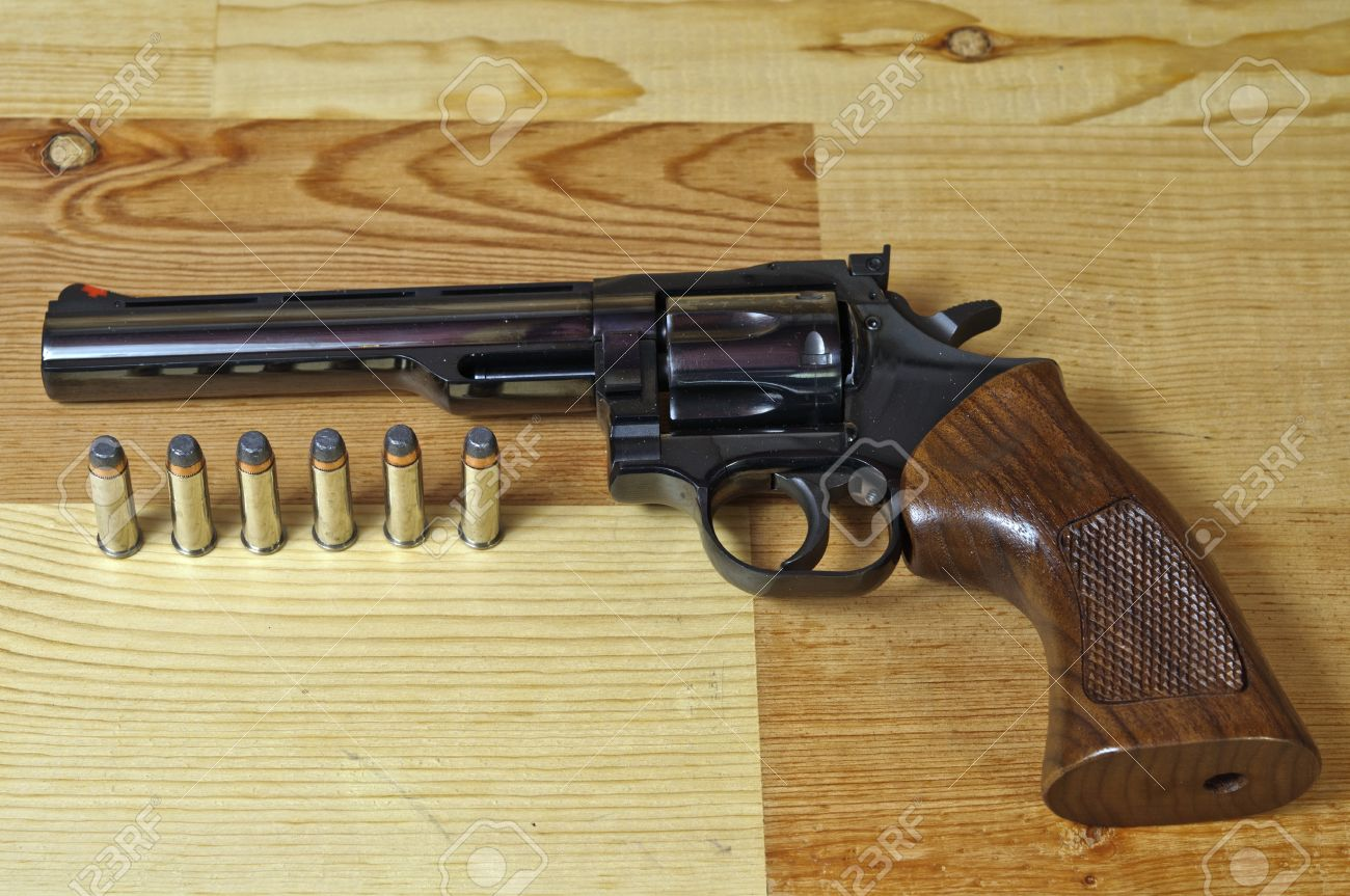 357 Magnum revolver with bullets on wood background Stock Photo - 11645221