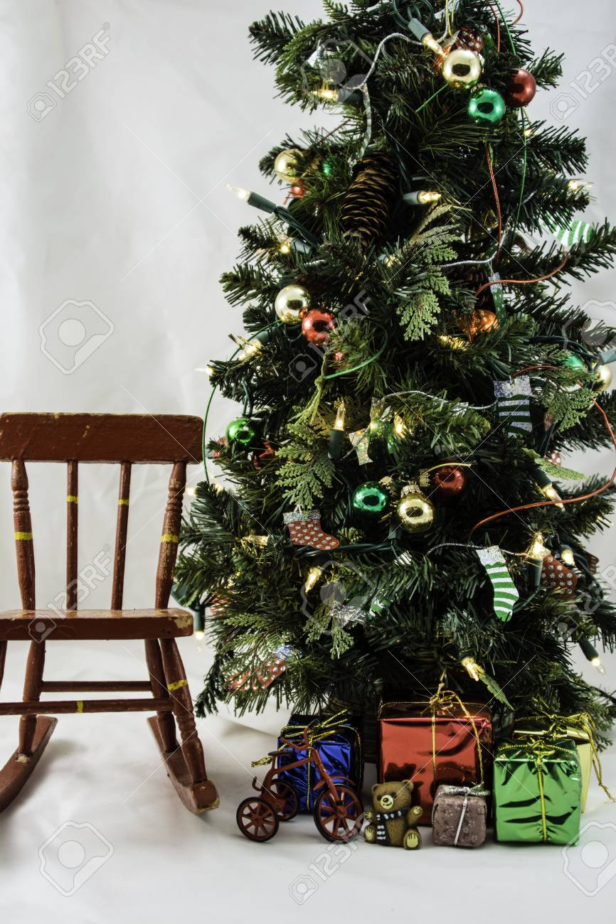 Brilliant Craft Decorated Christmas Tree Presents And Red Rocking Chair Machost Co Dining Chair Design Ideas Machostcouk