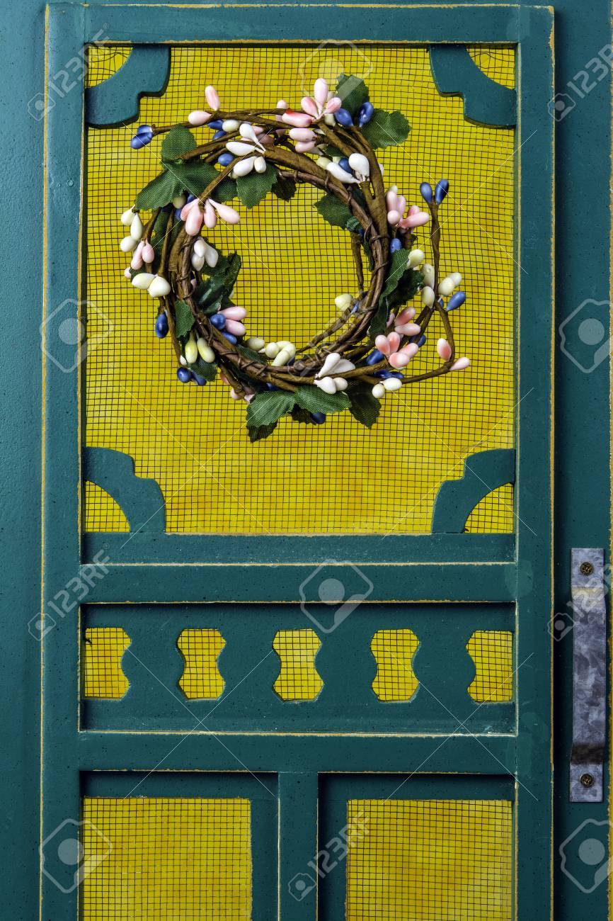 Green Screen Door With Spring Wreath Stock Photo Picture And