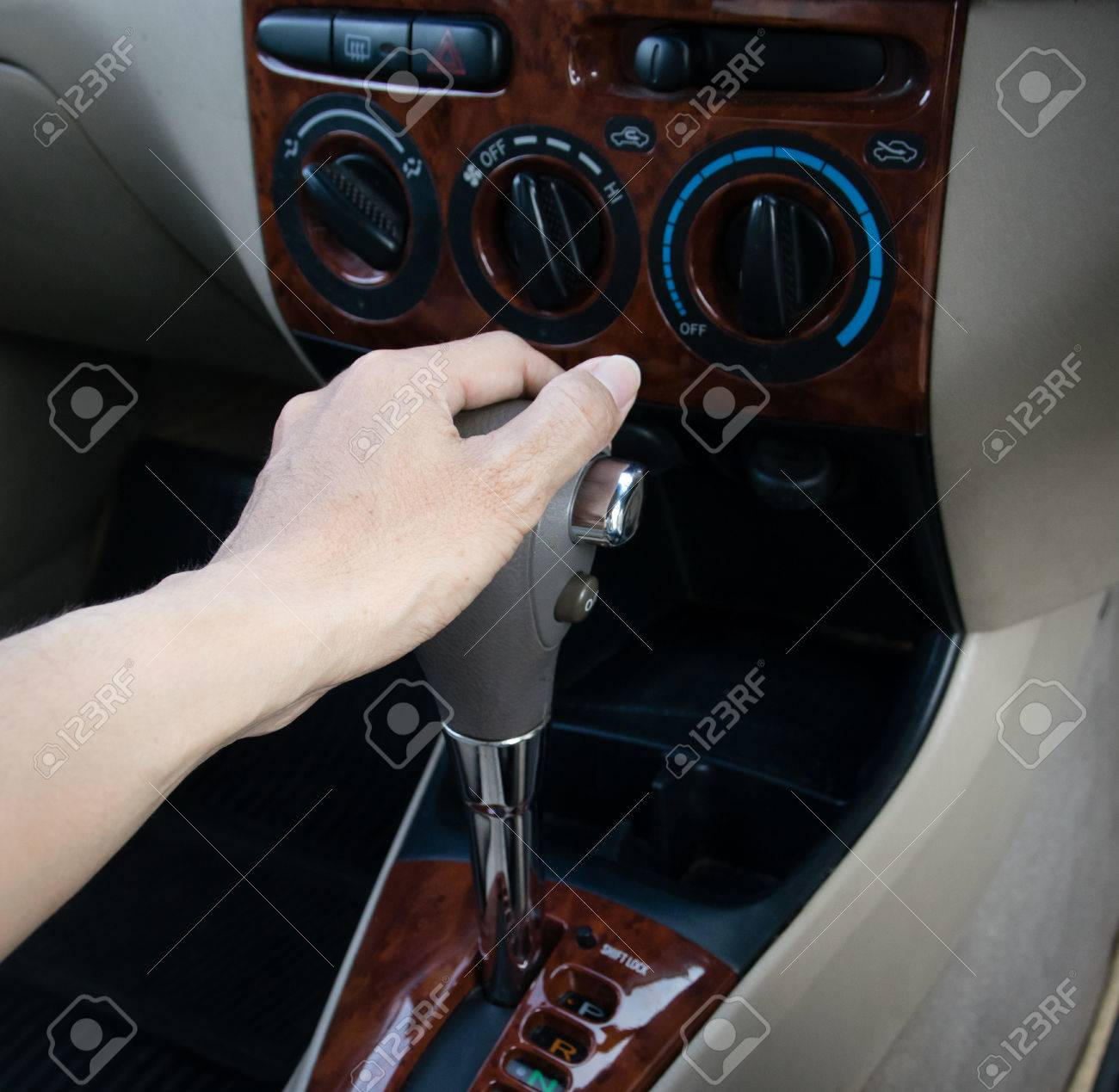 hand on automatic gear shift, Man hand shifting an automatic