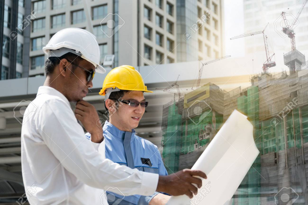 Engineer and architect working at construction site with blueprint engineer and architect working at construction site with blueprint stock photo 75370191 malvernweather Image collections