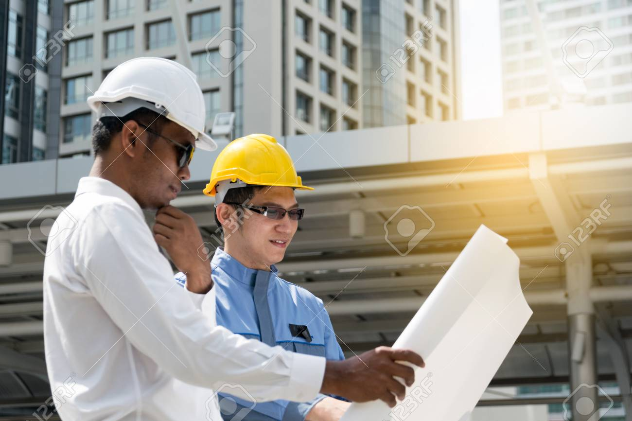 Engineer and architect working at construction site with blueprint engineer and architect working at construction site with blueprint stock photo 75043711 malvernweather Image collections