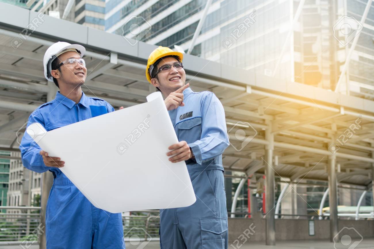 Engineer and architect working at construction site with blueprint engineer and architect working at construction site with blueprint stock photo 74265136 malvernweather Image collections