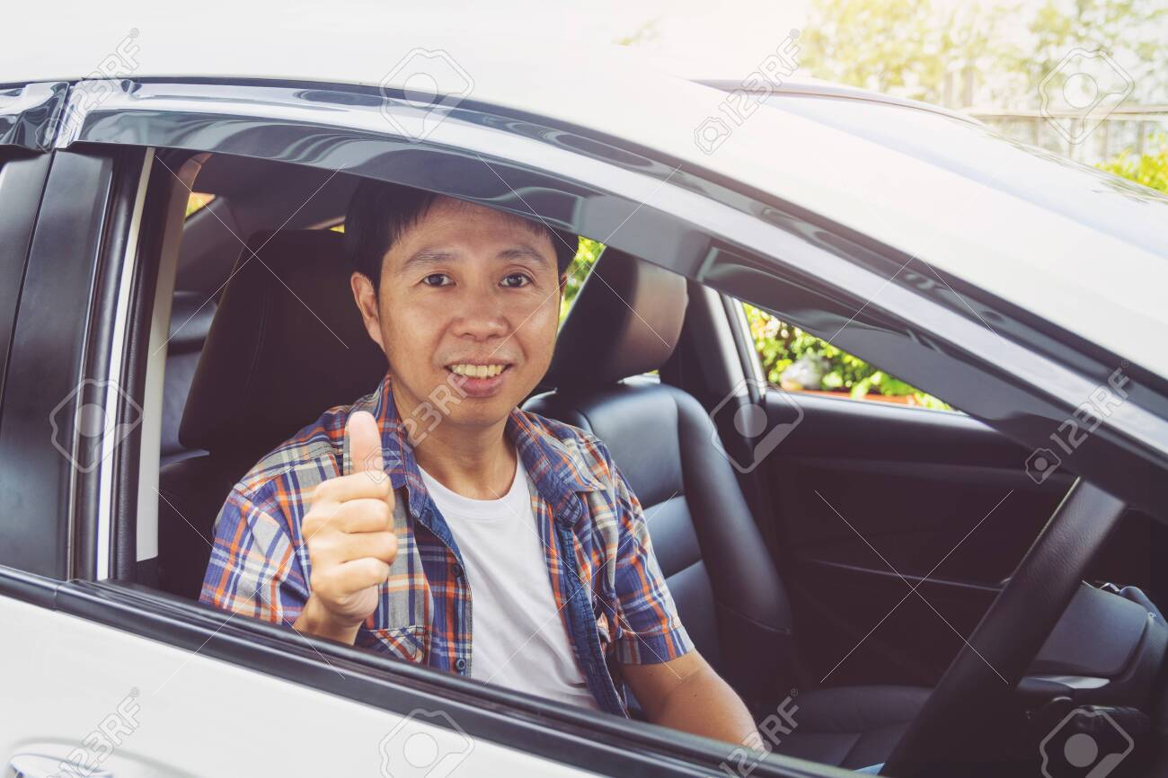 Asia man smile happy and drive car - 124528912