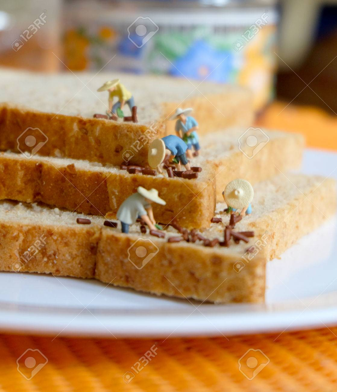 Miniature Farmer on Bread Stock Photo - 75137206