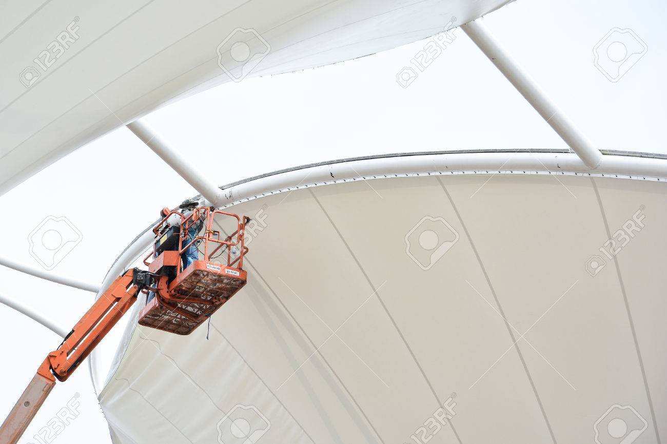 Technician install tensile fabric structure - 38681775