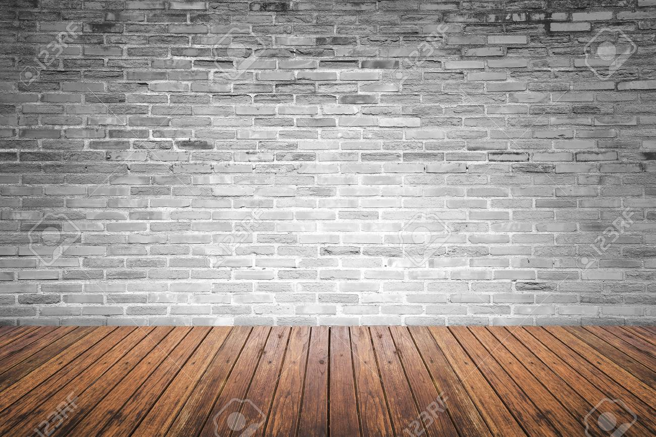 Old interior room with broken gray brick wall and grunge wood floor texture - 40968585