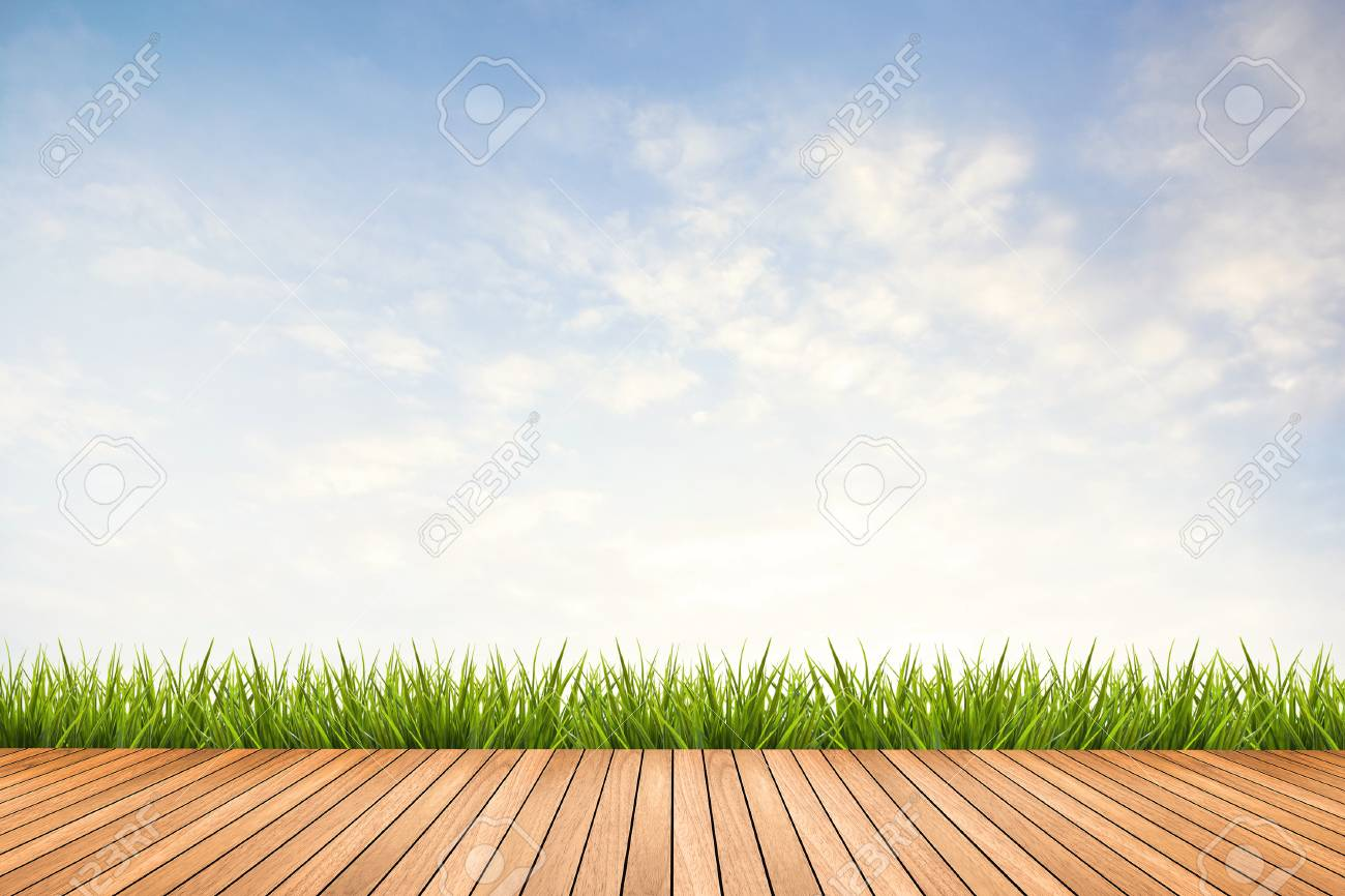 Wood texture terrace with fresh green grass under the blue sky and clouds of summer, use for background - 43218516