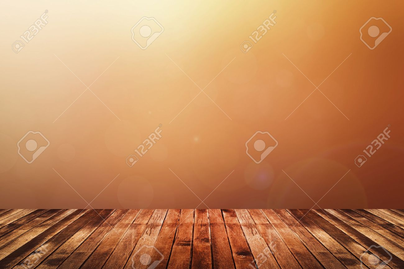 Dark brown wooden floor with abstract blurred background in warm tone color red, orange and yellow. use for backdrop or web design - 43218943