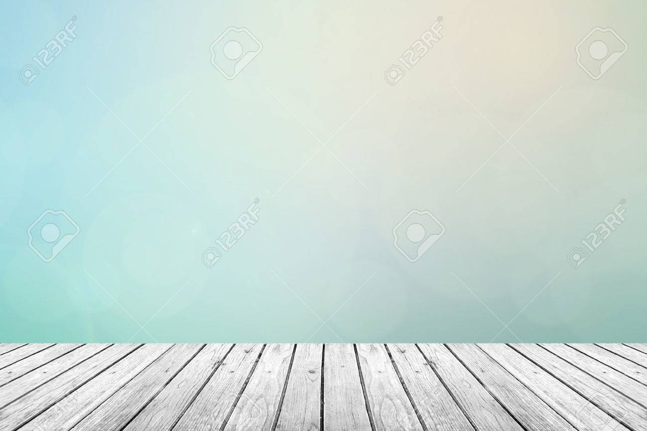 Gray Grey wooden floor with abstract turquoise blurred background in pastel sky tone color - 44974892