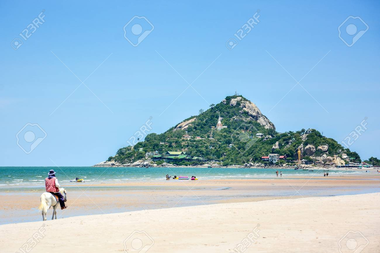 man ride the white horse on the beach of Khao Takiab, tropical sea of Hua Hin District,Thailand - 44974272