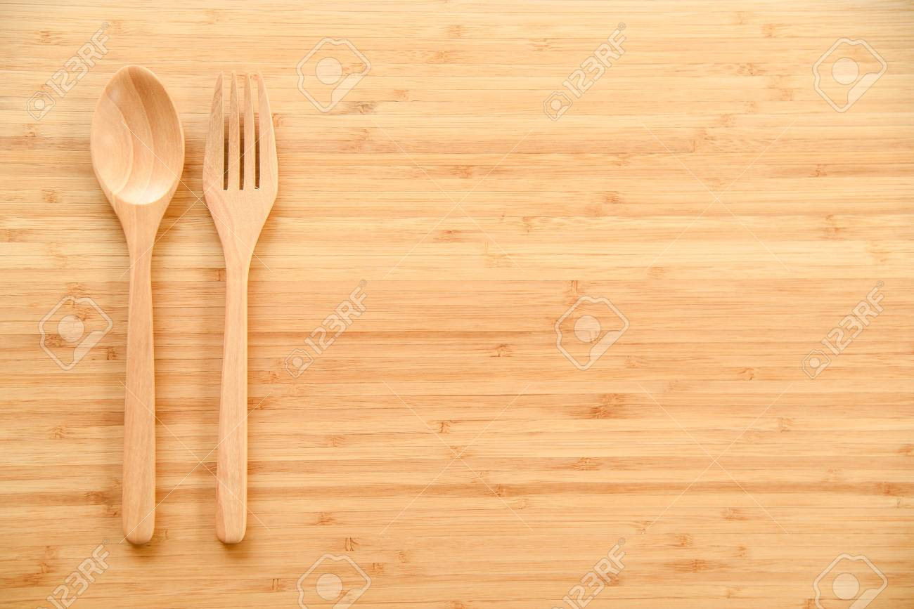 Stock Photo   Wooden Spoon And Fork On Wood Texture Of Dining Table From  Top View   Use For Background In Kitchen And Food Concept