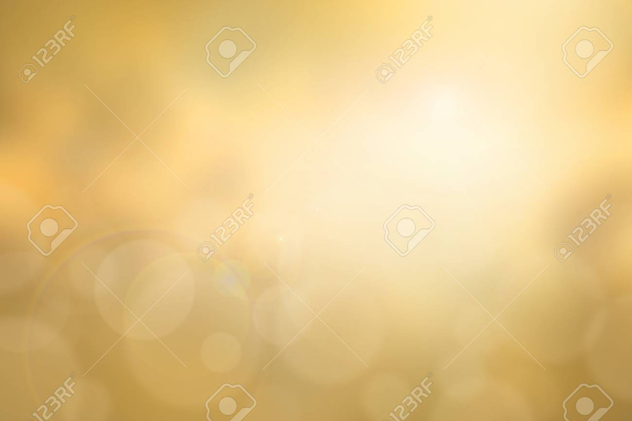 Abstract yellow sunset blurred background with bright sunlight, flare and bokeh effect, use for backdrop or design element in summer environment concept - 54827127