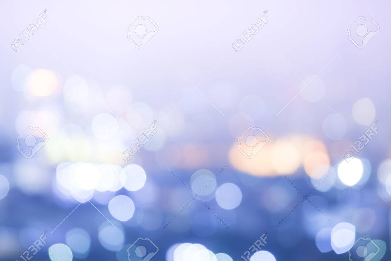 Abstract colorful blur bokeh night city life in vintage violet and purple tone, blurry view of urban street lights background - 64451543