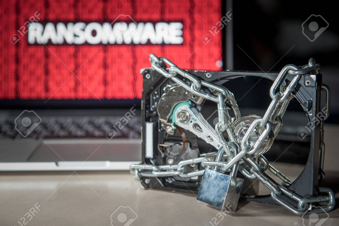 Hard disk file locked with monitor show ransomware cyber attack internet security breaches. Malware lock file concept for security article i.e. WannaCry or WannaCrypt attack all over the world - 78642483