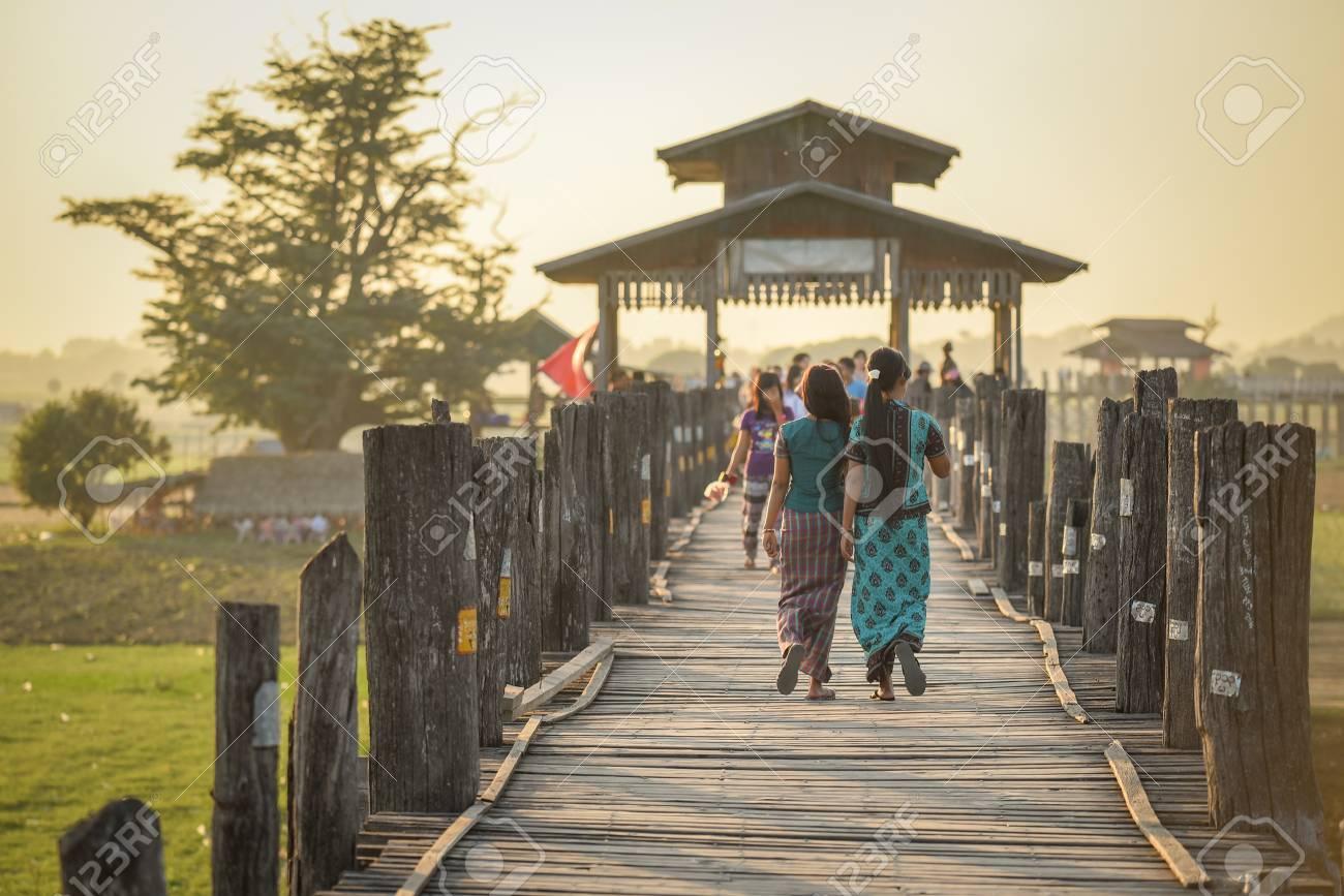 Unidentified Couple Burmese Woman Walk On U Bein Bridge At Sunset