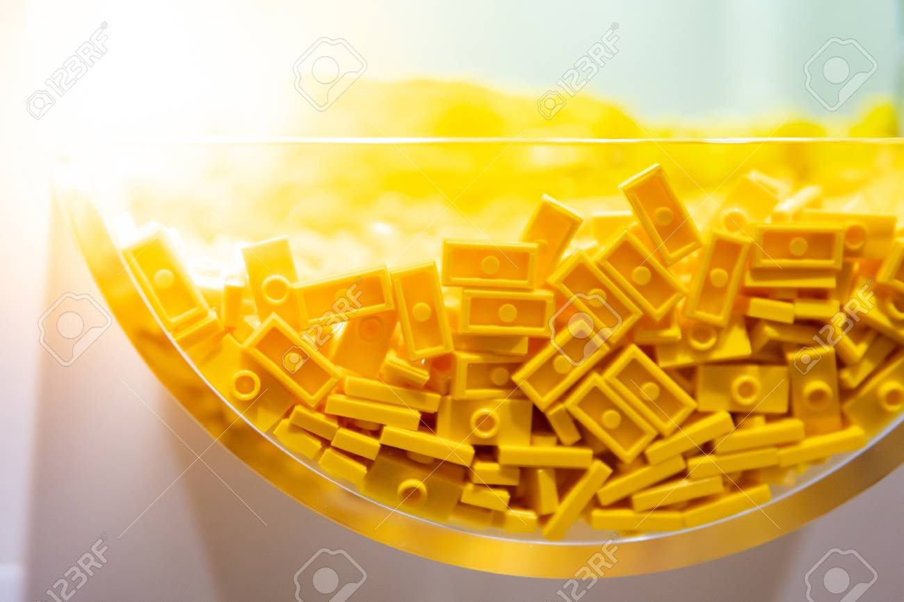 Close up of plastic toy bricks inside self service container shelf display in Kids toy store. - 122381851