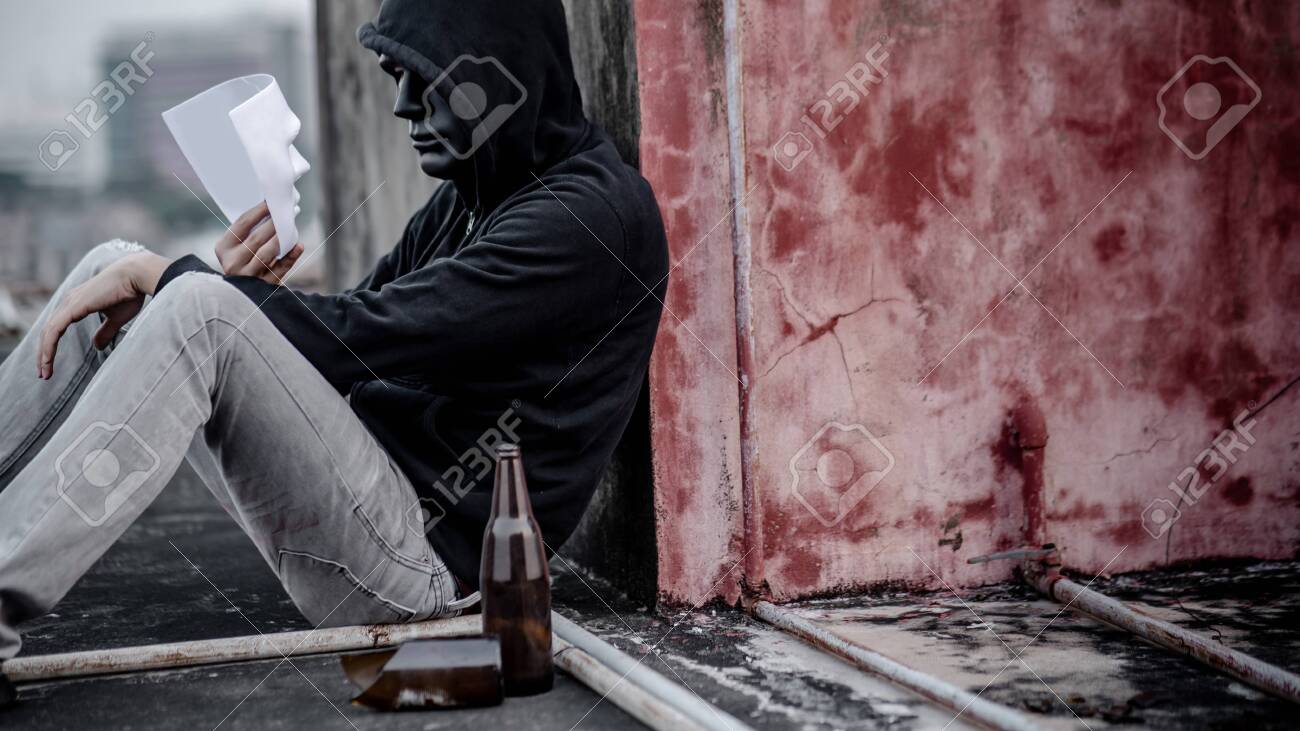 Mystery Man In Black Mask And Hoodie Jacket Holding White Mask Stock Photo Picture And Royalty Free Image Image 149651483