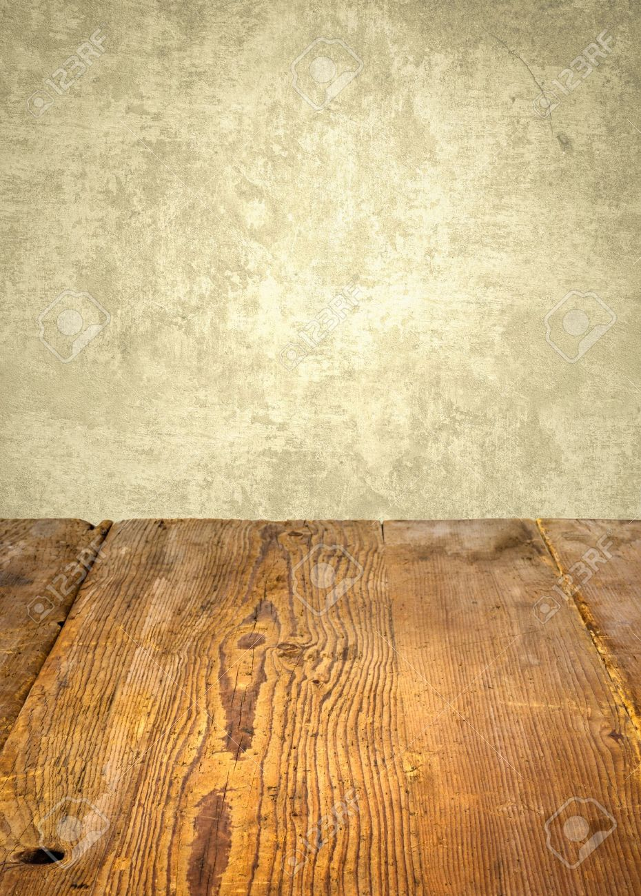 Antique Wooden Table In Front Weathered Wall Stock